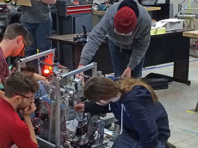Students hard at work on the robot